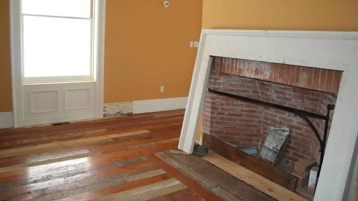 The Rumford fireplace in the dining room, one of four in the house. The surround is not yet complete.