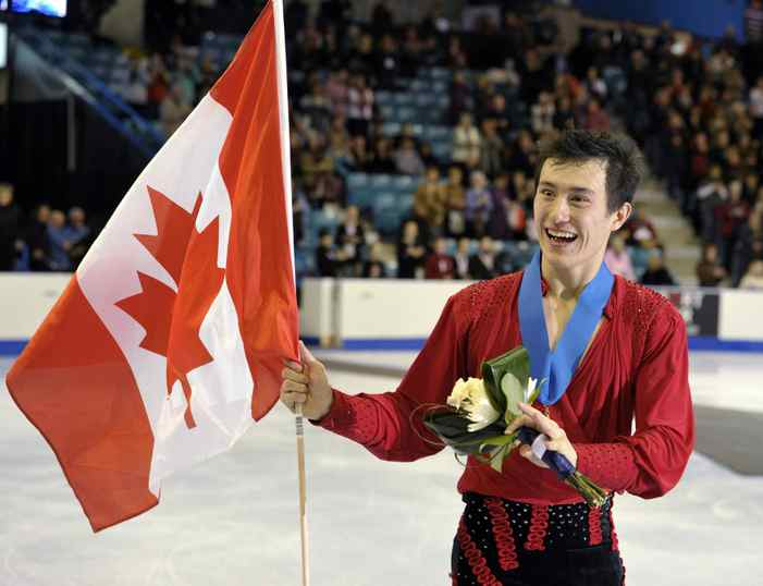 Patrick Chan skates with a Canadian flag after being presented with his gold medal at the Canadian Figure Skating Championships in Moncton, New Brunswick January 22, 2012.