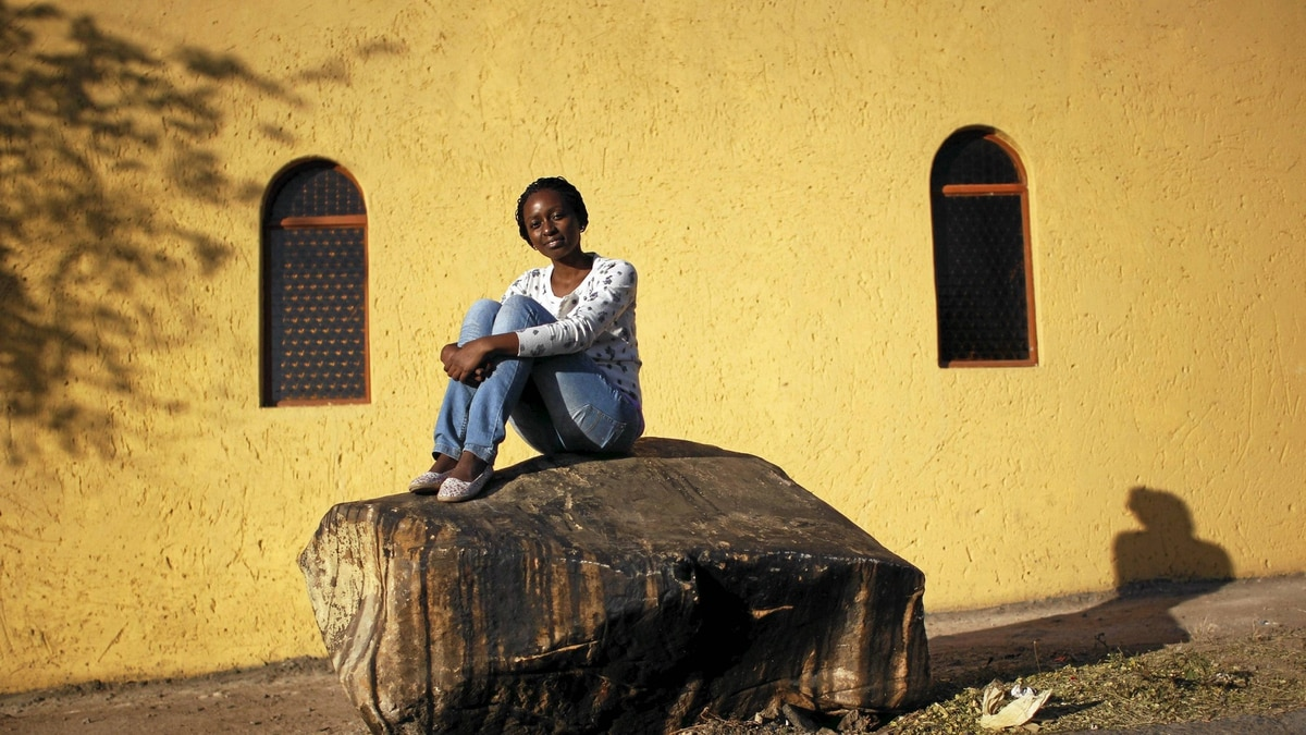 Thato Mokoena, current South African delegate for the G(irls)20 Summit 2012, poses in Alexandra, her native township, May 2012