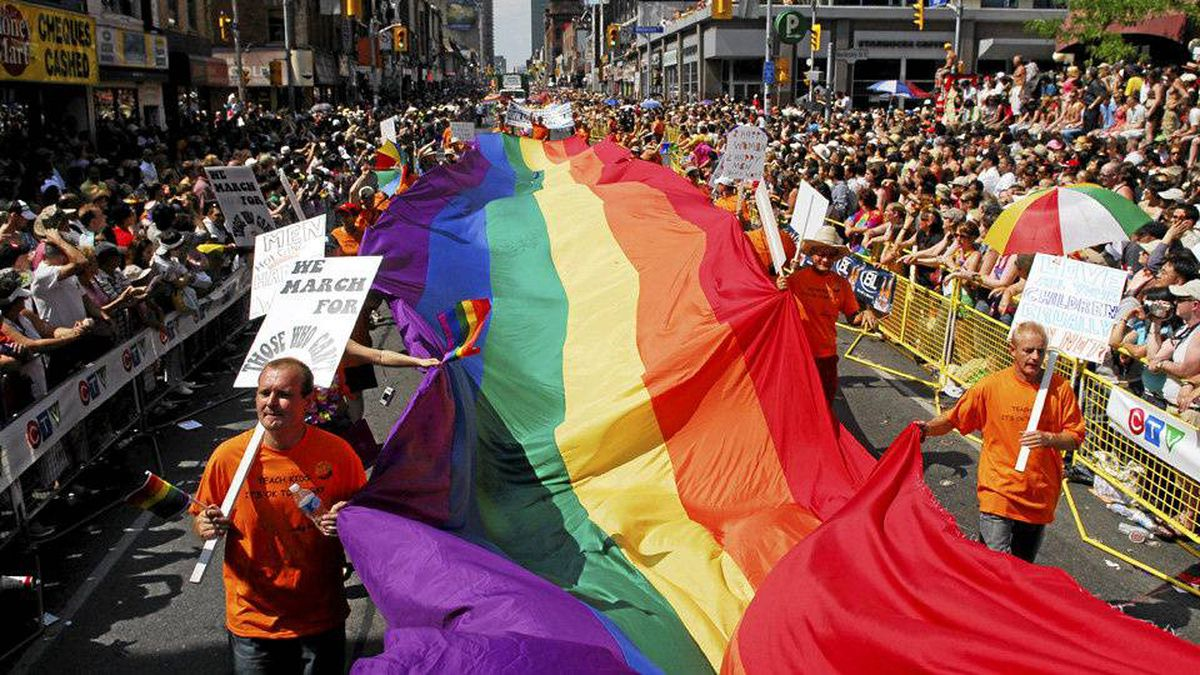 Revellers make their way down Yonge Street during the Gay Pride Parade in Toronto Sunday, June 24, 2007.