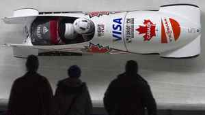 Canada's Helen Upperton and Shelly-Ann Brown (L) head to a third place finish during the women's World Cup Bobsleigh in Whistler, British Columbia February 2, 2012. REUTERS/Andy Clark