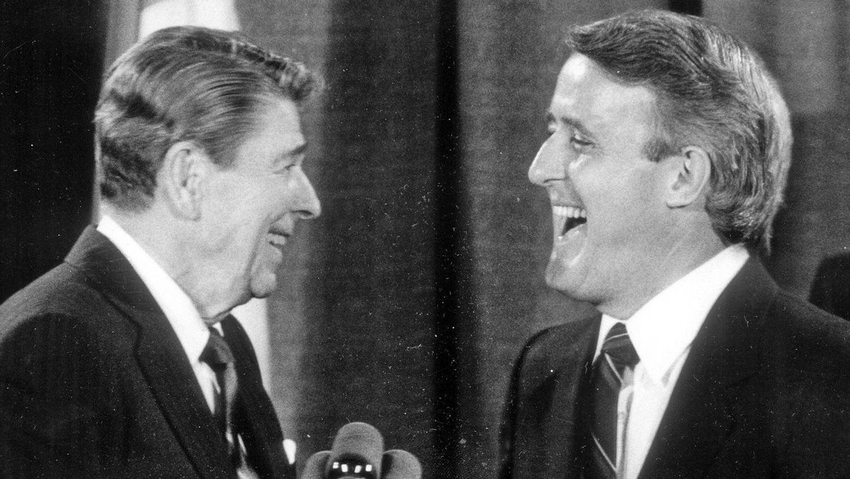 U.S. President Ronald Reagan and Prime Minister Brian Mulroney share a laugh at a G7 Summit in Toronto on June 21, 1988.