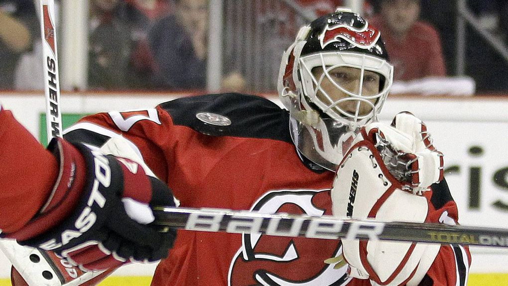 ... New Jersey Devils goalie Martin Brodeur blocks the puck with his  shoulder during the first period 7c226e42c