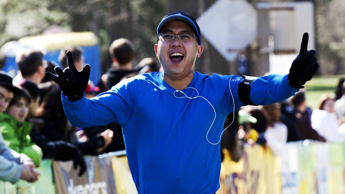 Andrew Chak celebrates as he crosses the finish line in Toronto's High Park on Saturday.