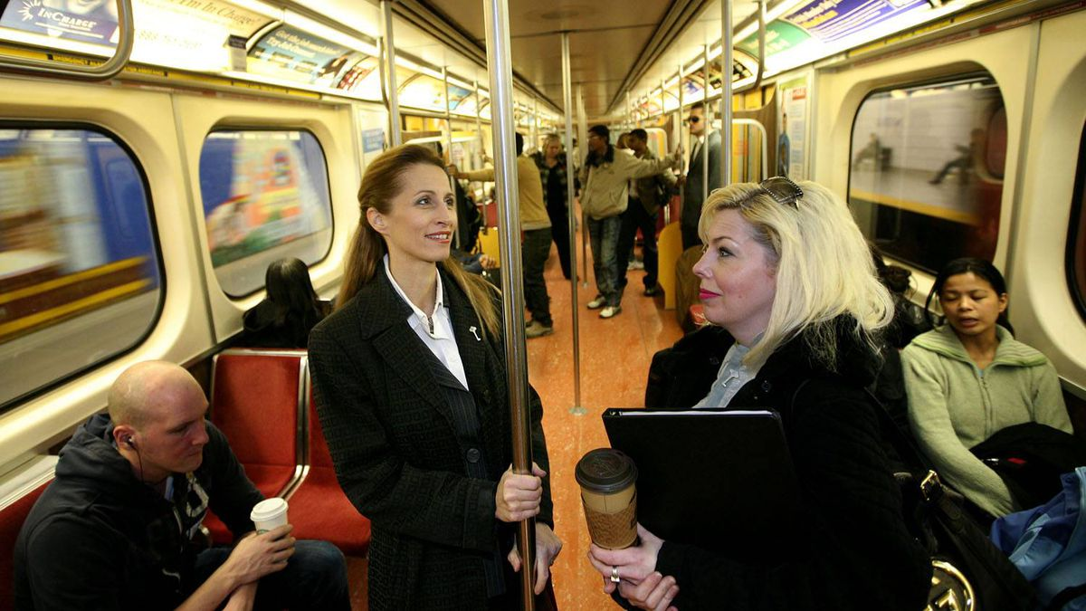 Sarah Thomson, left, rides the Yonge Street line after unveiling her mayoral platform, which would fund subway expansion with tolls on roads. Tim Fraser for The Globe and Mail