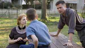 From left: Jessica Chastain, Tye Sheridan, and Brad Pitt in The Tree of Life.