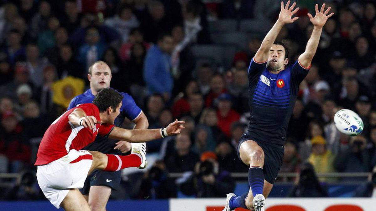 France's Morgan Parra attempts to block a kick from Wales' James Hook during their Rugby World Cup semi-final match at Eden Park in Auckland .