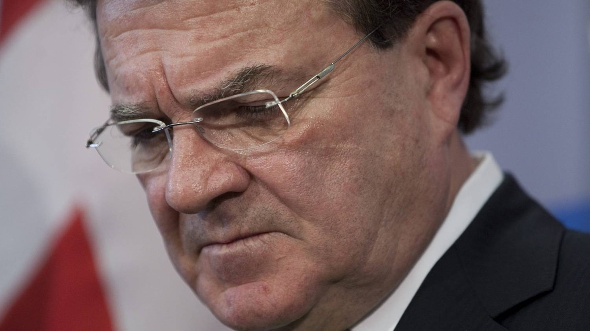 Minister of Finance Jim Flaherty listens to a question during a news conference prior to delivering the federal budget in Ottawa, Tuesday March 22, 2011.