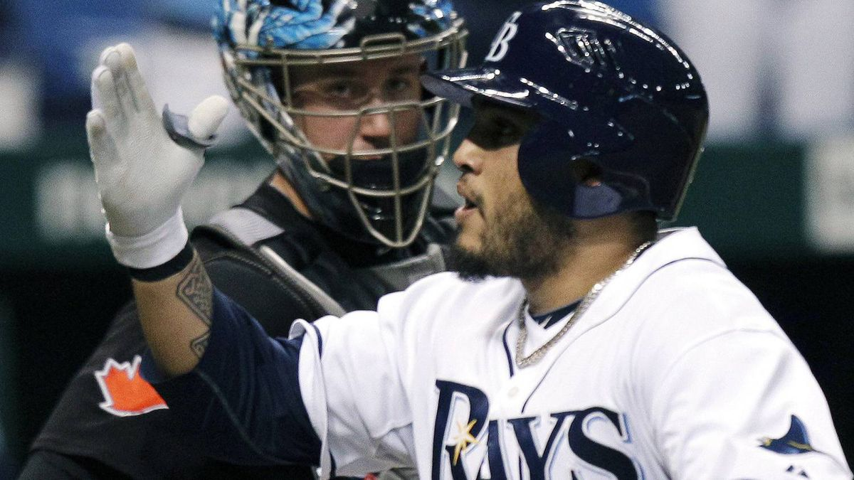 Tampa Bay Rays' Dioner Navarro, foreground, blows a kiss to the crowd after hitting a fourth-inning home run off Toronto Blue Jays pitcher Shaun Marcum during a baseball game Wednesday, June 9, 2010, in St. Petersburg, Fla. Looking on is Blue Jays catcher John Buck. (AP Photo/Chris O'Meara)