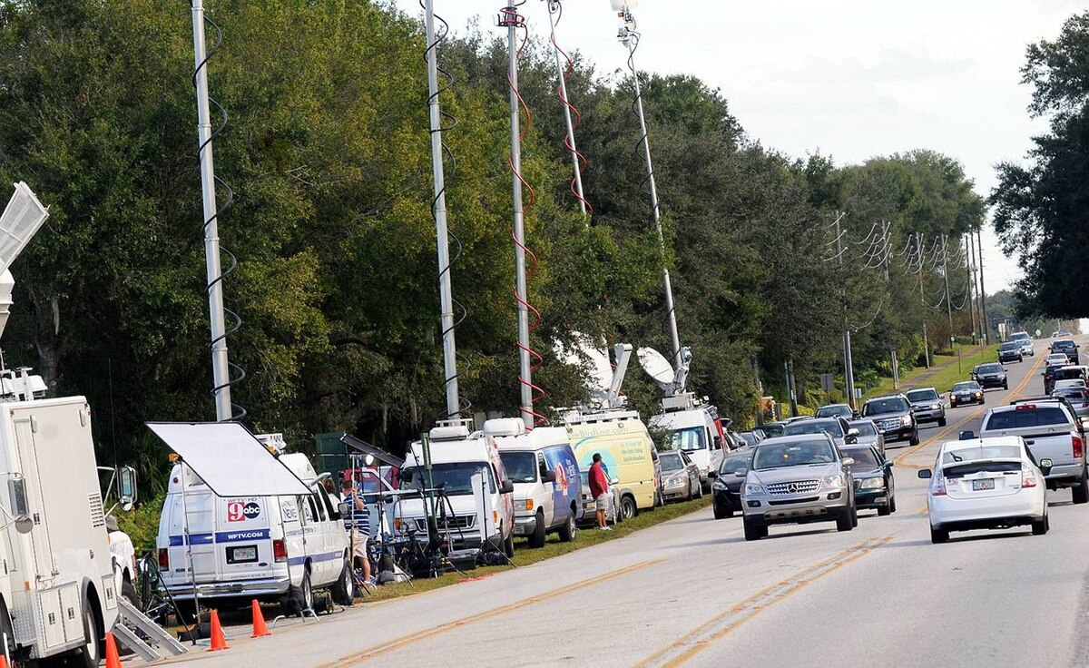 Media park outside of the Isleworth community, home to Tiger Woods on Nov. 30, 2009 in Windermere, Florida.