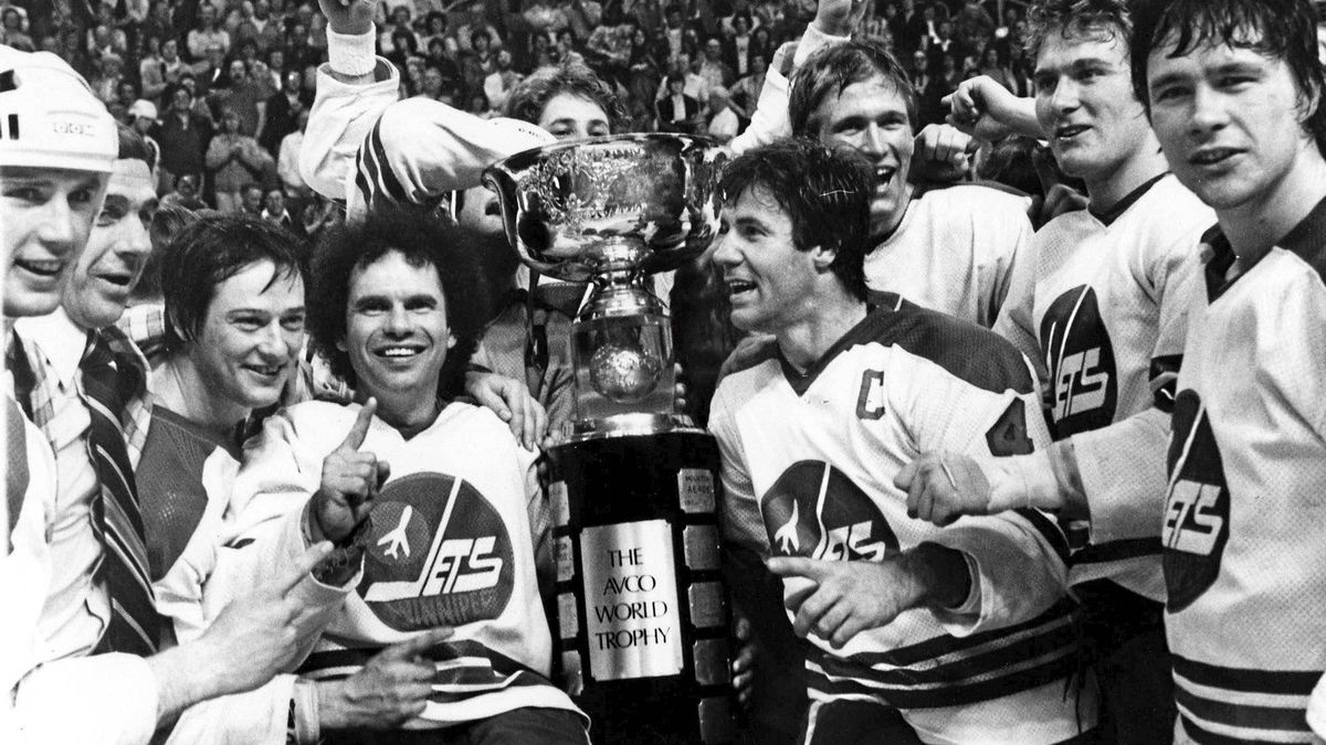 Members of the Winnipeg Jets including captain Lars-Erik Sjoberg, center right, and Jimmy Mann, center left, pose for a team photo with the Avco Cup after the Jets beat the Edmonton Oilers 7-3 to capture the final WHA championship four games to two in Winnipeg in this May 20, 1979 photo.