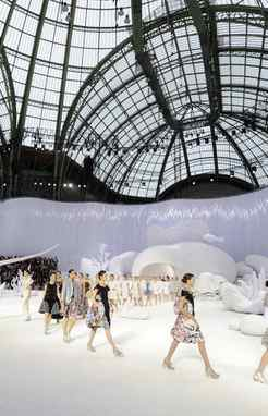 Chanel Spring/Summer 2012 ready-to-wear collection Held in the Grand Palais, a soaring Beaux Arts hall that dates back to 1900, the Chanel show is the largest of Paris Fashion Week. The amphitheatre-style seating encircled a bleached-out ocean floor, complete with sandy ground cover and massive sea forms. There were even glass-ball bubbles.
