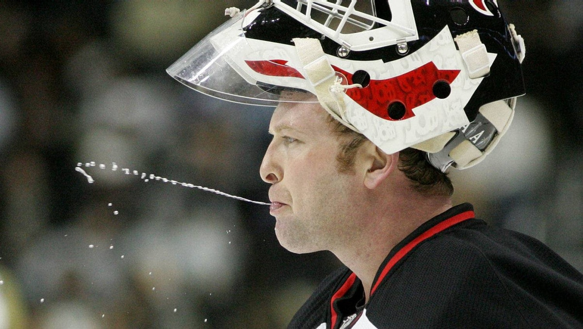 New Jersey Devils goalie Martin Brodeur (30) expectorates water after getting a drink during a break against the Pittsburgh Penguins during the third period at the CONSOL Energy Center. The Devils won 3-1. Charles LeClaire-USPRESSWIRE
