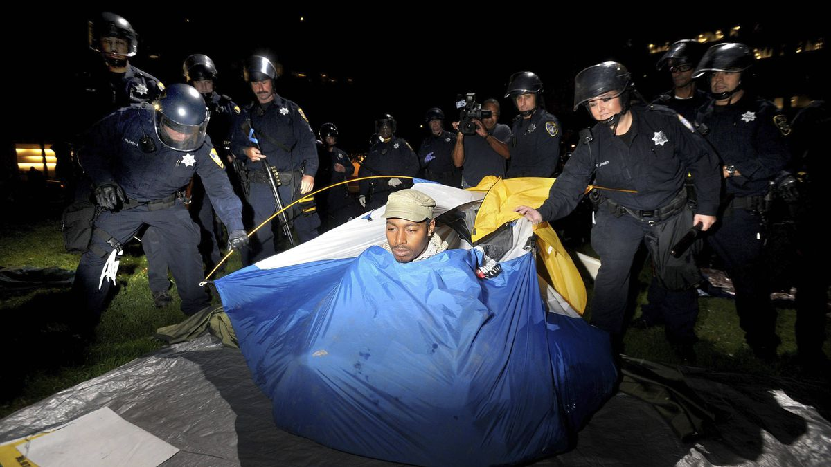 Police remove an Occupy Oakland camper from Snow Park on Oct. 25, 2011, in Oakland, Calif.