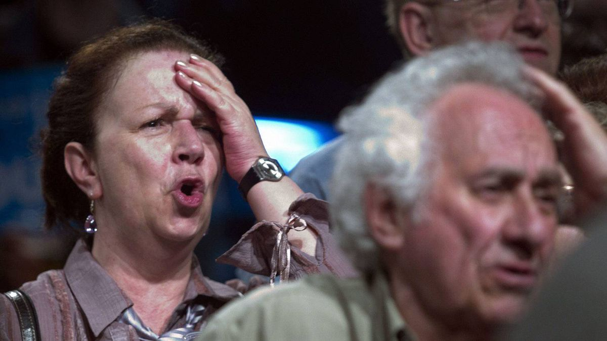 Bloc Quebecois supporters react after hearing their leader Gilles Duceppe failed to win his riding at federal election night headquarters in Montreal May 2, 2011.
