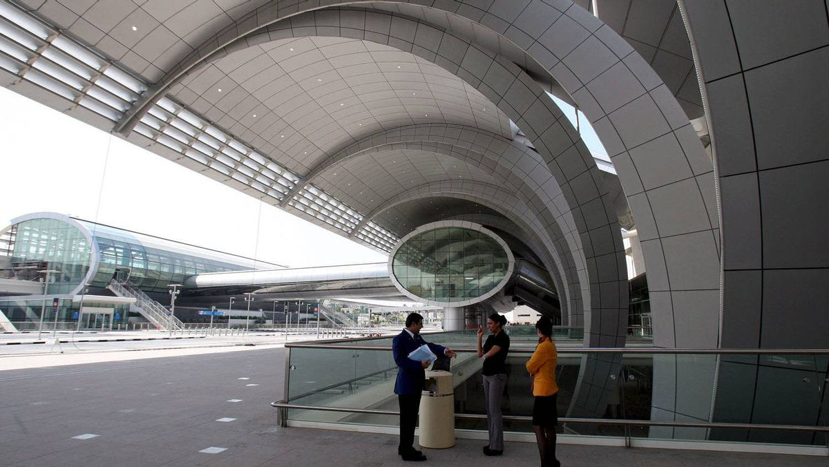 Employees stand at the entrance of Dubai Terminal 3 in this file picture, Oct. 9, 2008, days before the terminal was slated to open to the public.