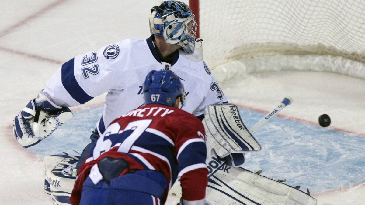 Montreal Canadiens' Max Pacioretty (67) scores on Tampa Bay Lightning's goalie Mathieu Garon during second period NHL hockey action in Montreal January 7, 2012. REUTERS/Christinne Muschi