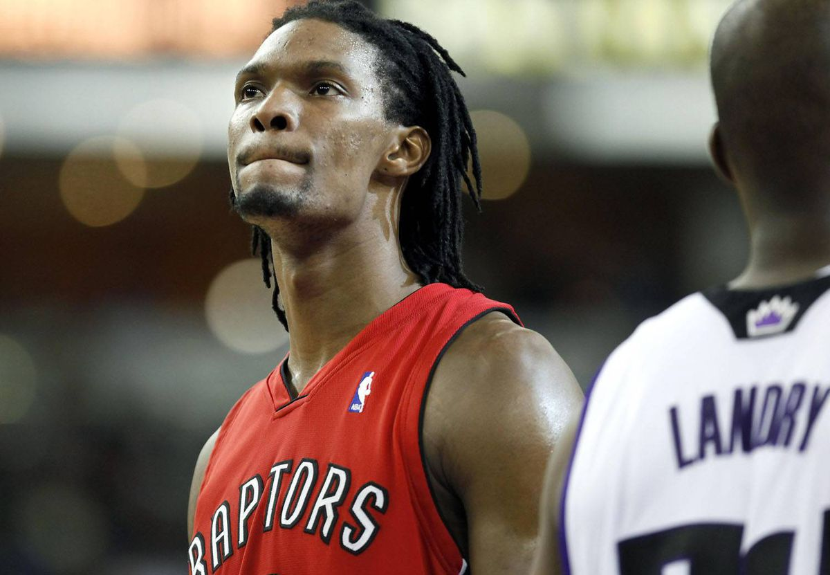 Toronto Raptors forward Chris Bosh, left, looks at the scoreboard late in the second half of an NBA basketball game against the Sacramento Kings in Sacramento, Calif. Steve Yeater/AP