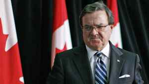 Finance Minister Jim Flaherty leaves an Ottawa news conference on Oct. 13, 2011.