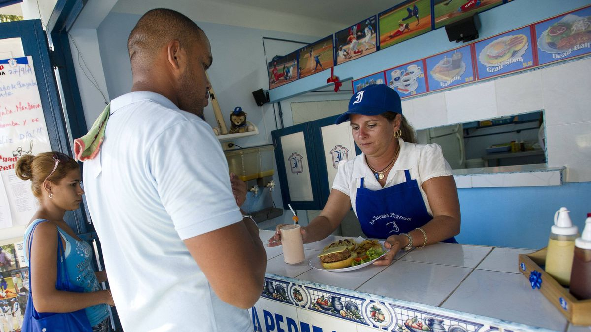 Cubans wait to order their meals at The Perfect Play in Havana, Cuba Sept. 27, 2011. The small restaurant has adopted a baseball theme that pays homage to the much loved local team the Industriales.