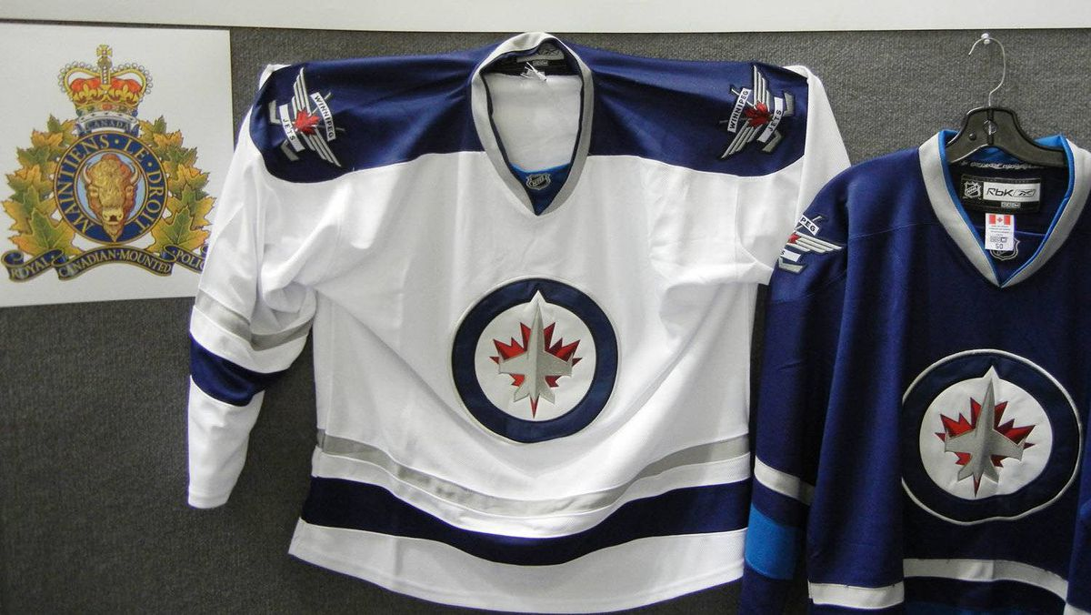 Mounties and Canada Border Services Agency seized a shipment of counterfeit jerseys bearing the newest NHL team's logo and shoulder flashes last week, pictured in this handout photo.