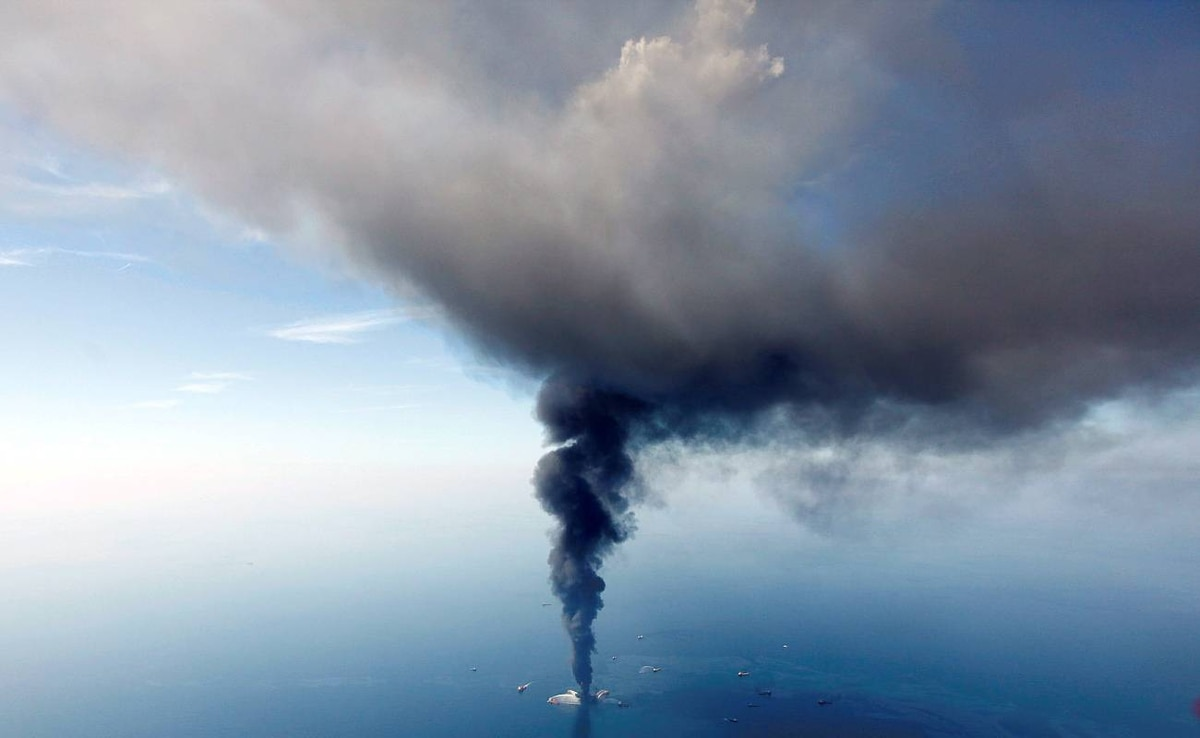 In this aerial photo taken in the Gulf of Mexico more than 50 miles southeast of Venice on Louisiana's tip, the Deepwater Horizon oil rig is seen burning Wednesday, April 21, 2010. (AP Photo/Gerald Herbert)
