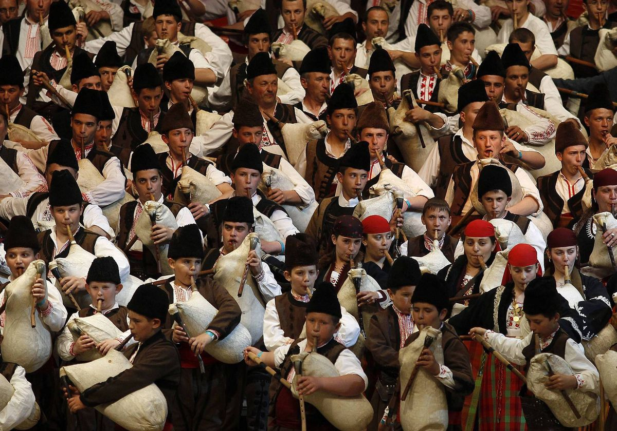 Some 333 Bulgarian bagpipers play their instruments in an attempt to set a world record at the National Palace of Culture in Sofia. The performers aim for an entry in the Guiness Book of World Records for the largest-scale performance of bagpipers.