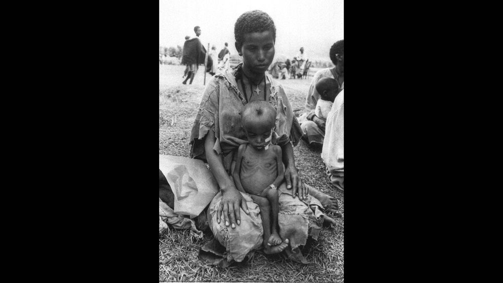 73f1f6142af05 ... An Ethiopian child sat in his mother s lap at the Wad Sherife refugee  camp in Sudan