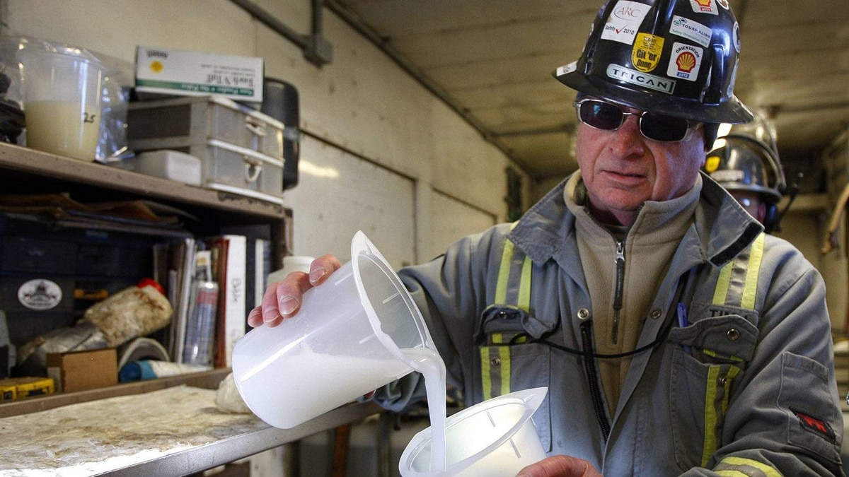 Tim Irons, a quality-control technician, checks the state of fluid that will be pumped into the ground during the hydraulic fracturing process at an operation near Bowden, Alta.