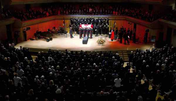 Pallbearers carry the coffin of late NDP leader Jack Layton at his state funeral service in Roy Thomson Hall.
