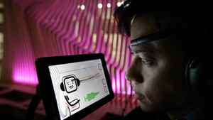 A computer screen displays Chris Aimone's brain waves (top purple line) (J.P. Moczulski for The Globe and Mail)