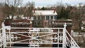 The view from the widow's walk takes in neighbouring heritage homes and the Ganaraska River shoreline.