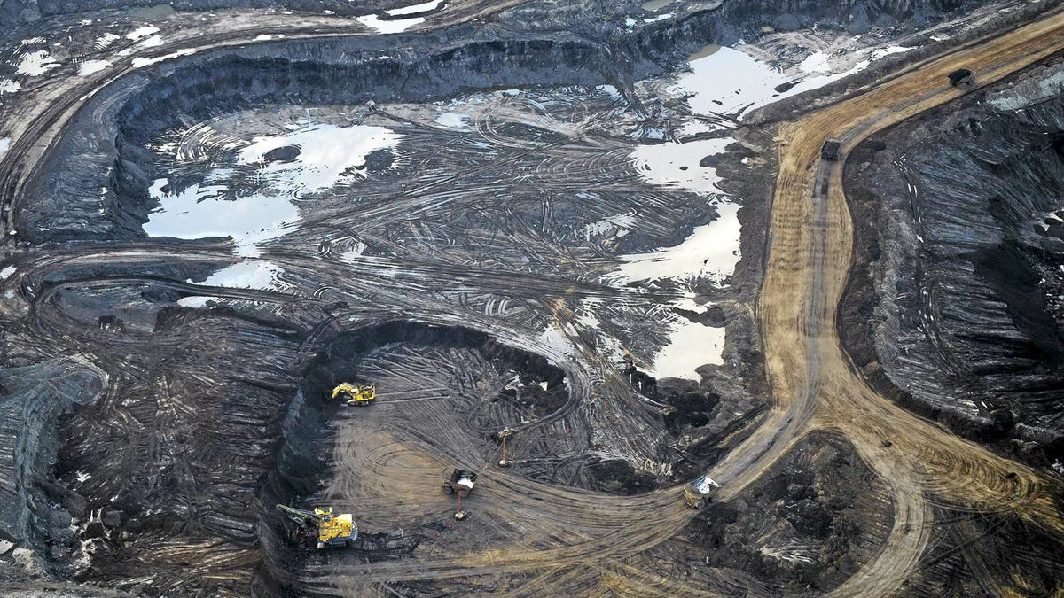 Large machinery can be seen at Suncor Millennium mine oil sands operation north of Fort McMurray, Alberta in an aerial photograph Aug. 31, 2010.