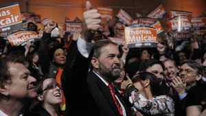 NDP leadership candidate Thomas Mulcair gives a thumbs up to supporters at the convention in Toronto March 24, 2011.