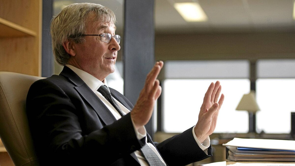 Canada's Chief Statistician Wayne Smith answers questions at his office at Stats Canada in Ottawa, Friday Feb. 11, 2011.
