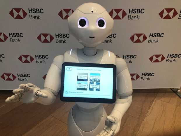 Banks turn to espresso, dancing robots to keep traditional