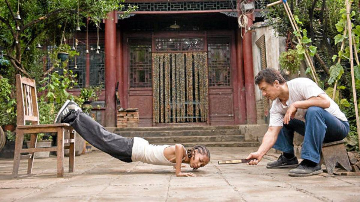 Jaden Smith as Dre Parker and Jackie Chan as Mr. Han in The Karate Kid.