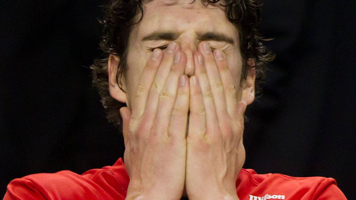 Canada's Frank Dancevic rubs his face after losing to France's Jo-Wilfried Tsonga in straight sets during a Davis Cup tennis singles match in Vancouver, B.C., on Sunday February 12, 2012. France defeated Canada to win the world group first round match up. THE CANADIAN PRESS/Darryl Dyck