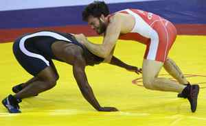 Sinvie Boltic of Nigeria fights Korey Jarvis of Canada in the men's 96KG Wrestling at IG Sports Complex during day six of the Delhi 2010 Commonwealth Games on October 9, 2010 in Delhi, India. (Photo by Ian Walton/Getty Images)