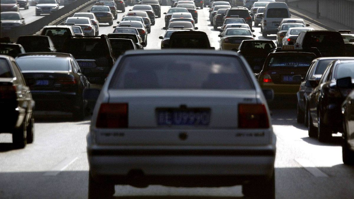 Motorists sit in their cars on a main road during a heavy traffic period in Beijing January 10, 2012.