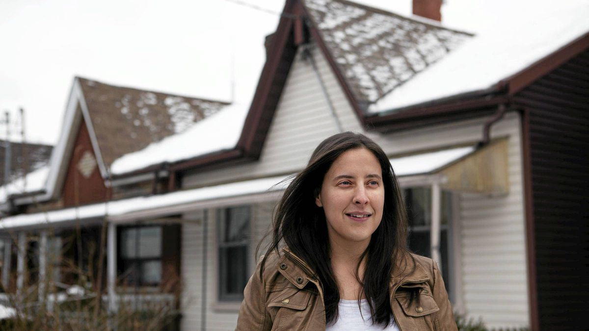 Melissa Hart stands in front of a west end home that was listed for almost $600,000.