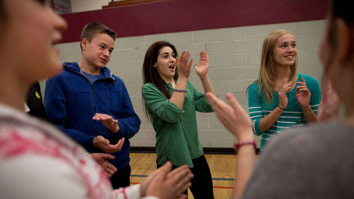 Students at Preston High School in Cambridge, ON congratulate each other as they participate in a day-long anti-bullying program presented by Phil Boyte Apr. 25, 2012.