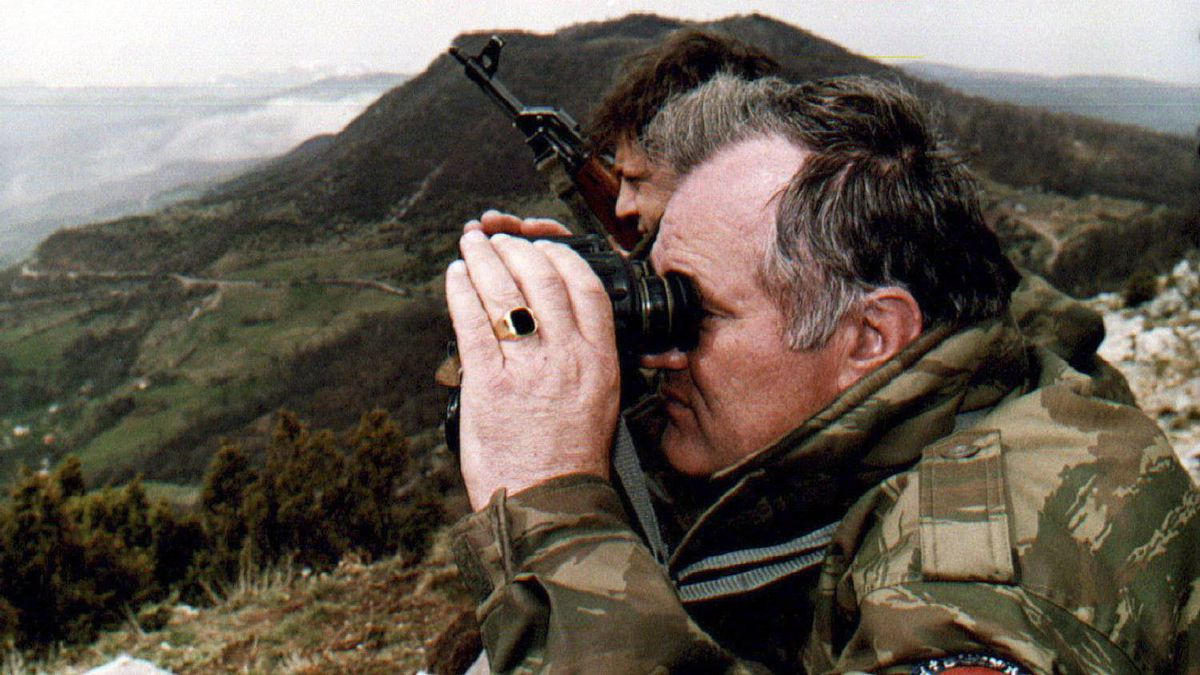 Bosnian Serb army commander Gen. Ratko Mladic monitors a battle against Muslim forces from his shelter on the top of a hill some 4 kilometres from the centre of eastern Bosnian city of Gorazde on April 16, 1994.
