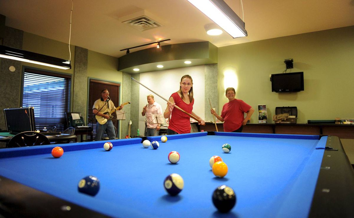 Workers at Cenovus's Christina Lake operation unwind by relaxing in the camp's games room, playing in a band or play in a daily floor hockey game south of Fort McMurray, Ab. Aug. 30, 2010. (Kevin Van Paassen/The Globe and Mail)