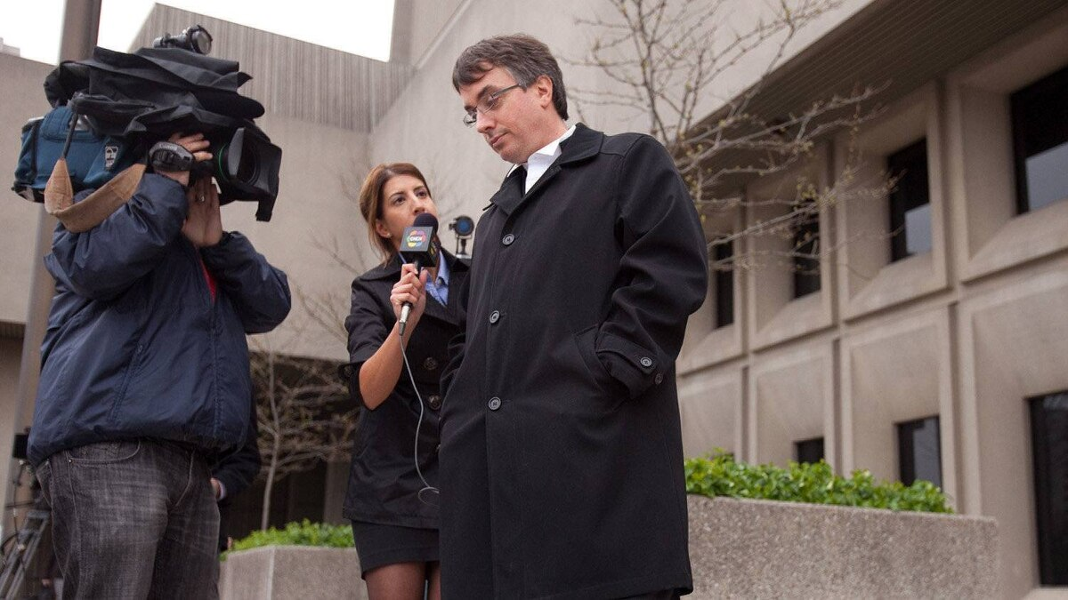Dirk Derstine, defence lawyer for Michael Rafferty, talks briefly with reporters during a break in proceedings at the trial in London, Ontario, Tuesday, May 1, 2012.