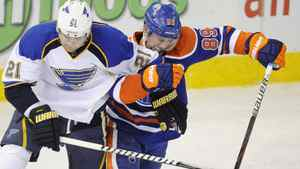 St. Louis Blues' Patrik Berglund, left, battles Edmonton Oilers' Sam Gagner during first period NHL hockey game action in Edmonton on Wednesday, February 29, 2012.