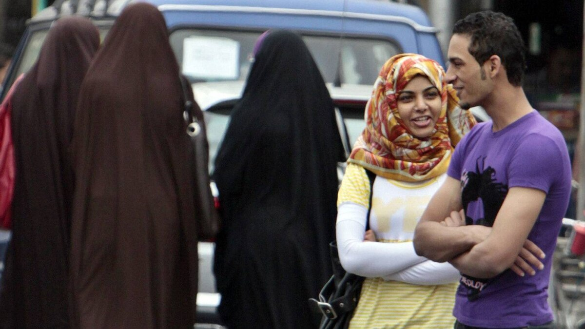 This Oct. 29, 2009 photo shows an Egyptian girl in Cairo wearing a hijab, right, which covers the hair but leaves the face uncovered, as others in the background wear the niqab, which covers the entire face except the eyes.