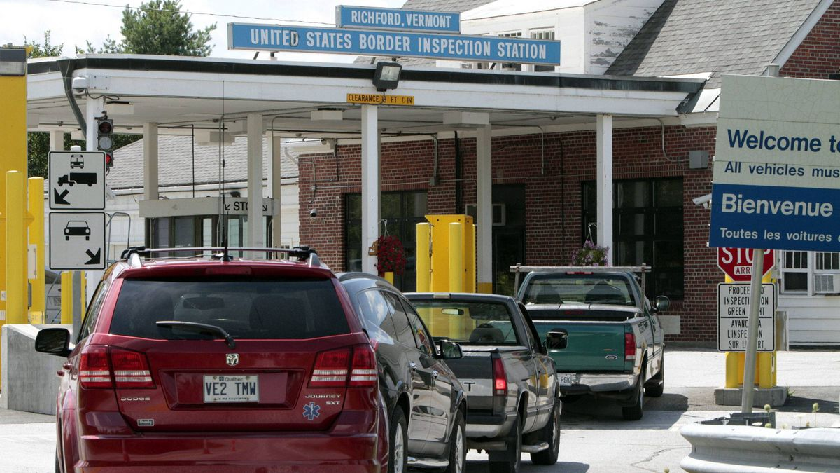 Cars line up at the United States port of entry from Canada in Richford, Vt.