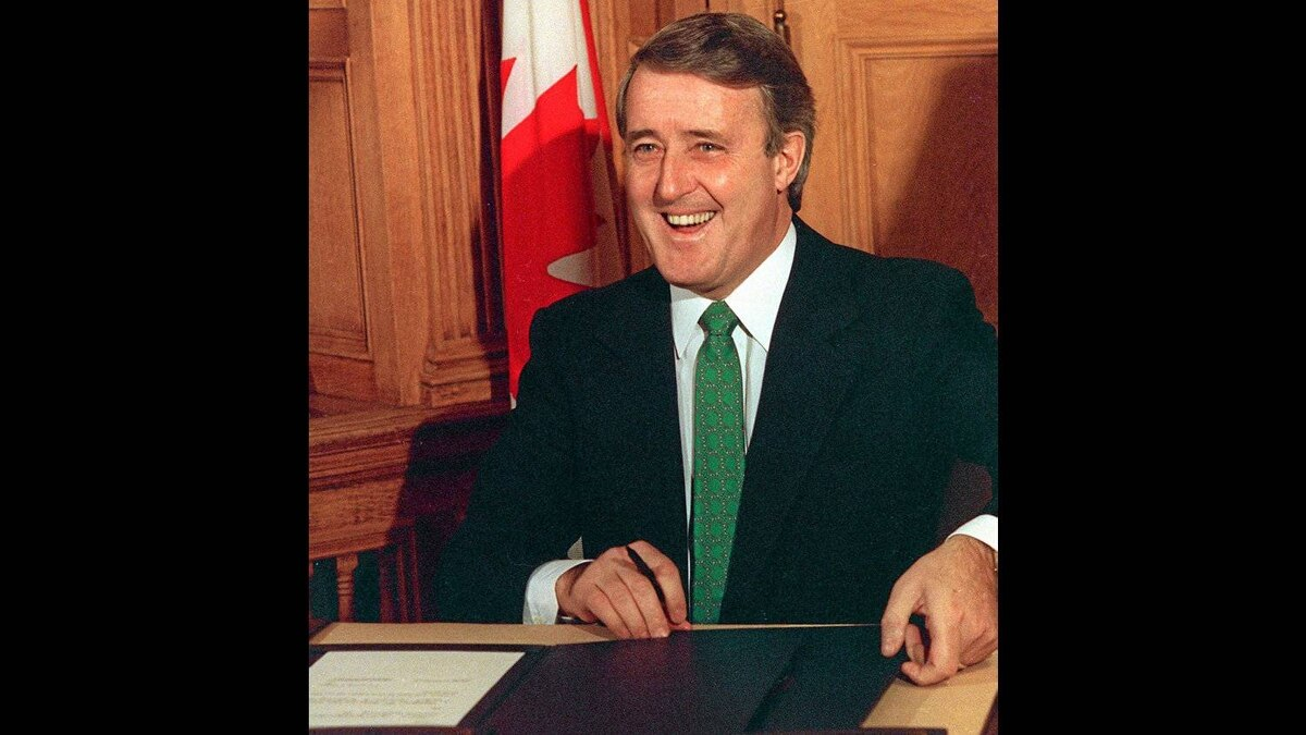 Prime Minister Brian Mulroney is all smiles before signing the proposed Free Trade Agreement between Canada and the United States. Prime Minister Mulroney did the signing in Ottawa, Saturday. 1988