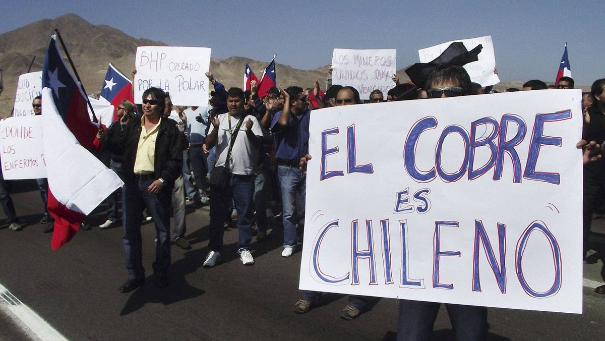Workers from Escondida copper mine march through the streets of Antofagasta, north of Santiago, July 25, 2011.